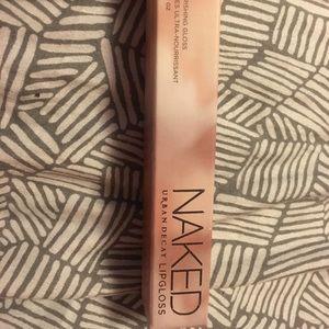 Urban Decay brand Naked Lip Gloss